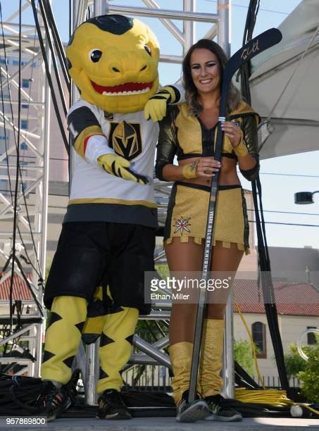 The Vegas Golden Knights mascot Chance the Golden Gila Monster and a member of the Vegas Golden Knights Golden Aces stand onstage as they help give...