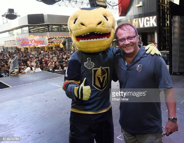 The Vegas Golden Knights mascot Chance the Golden Gila Monster and Golden Knights public address announcer Bruce Cusick pose onstage during the...