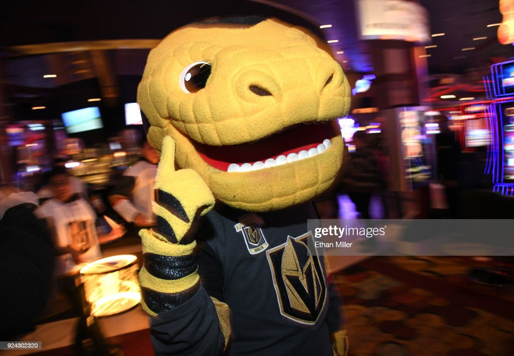 68438f381400 The Vegas Golden Knights mascot Chance the Golden Gila Monster helps ...