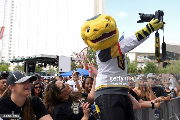 The Vegas Golden Knights mascot Chance the Golden Gila Monster jokes around with fans at a Golden Knights road game watch party for Game Three of the...