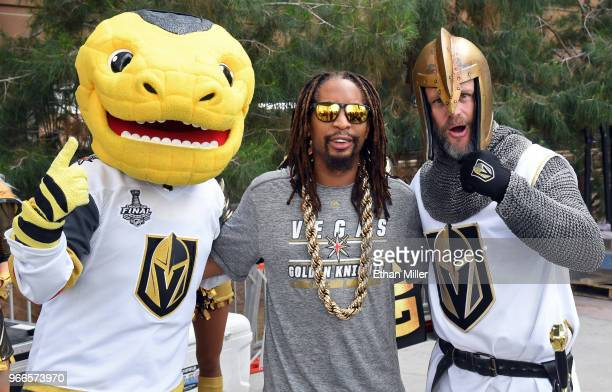 The Vegas Golden Knights mascot Chance the Golden Gila Monster rapper Lil Jon and Lee Orchard as the Golden Knight pose before a performance by Jon...
