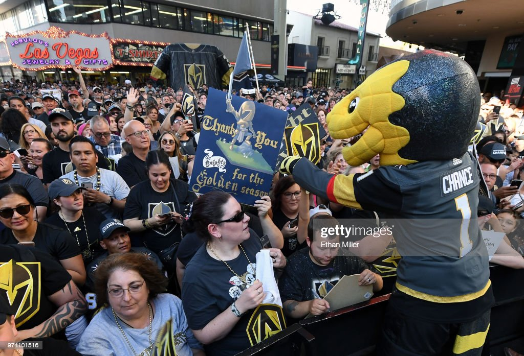 The Vegas Golden Knights mascot Chance the Golden Gila Monster signs autographs for fans during the team's 'Stick Salute to Vegas and Our Fans' event at the Fremont Street Experience on June 13, 2018 in Las Vegas. Nevada. The Golden Knights made it to the Stanley Cup Final in the team's inaugural season, losing to the Washington Capitals four games to one in the series.