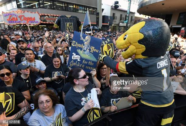 The Vegas Golden Knights mascot Chance the Golden Gila Monster signs autographs for fans during the team's 'Stick Salute to Vegas and Our Fans' event...