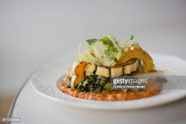 The vegetable entree at Chaval which consists of salt roasted celeraic delicata squash romesco swiss chard and olive tapenade
