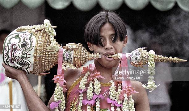The vegeterian Festival Phuket a local devotee with a trophy piercing his cheek this festival is known for self mutilation and occurs every year in...