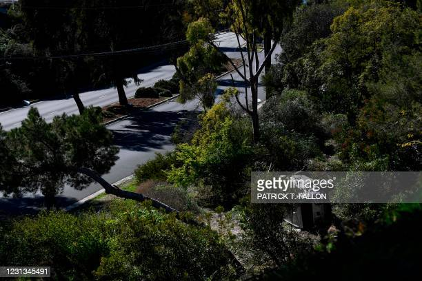 The vehicle driven by golfer Tiger Woods lies on its side in Rancho Palos Verdes, California, on February 23 after a rollover accident. - US golfer...