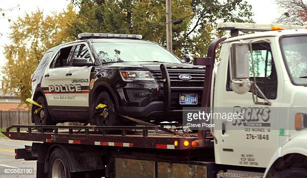 The vehicle driven by Urbandale Police officer Justin Martin when he was shot and killed is towed from the scene November 2 2016 in Urbandale Iowa...