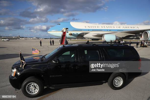 The vehicle for US President Donald Trump arrives to pick up the President from Air Force One at the Palm Beach International Airport so he can spend...