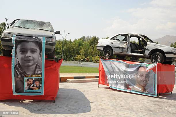 The vehicles of Iran's assassinated nuclear scientists with scars of explosion which led to their death are exhibited in the venue of Non Alligned...