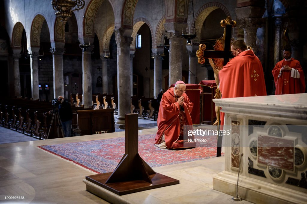 Veneration Of The Cross During Coronavirus Lockdown In Trieste : News Photo