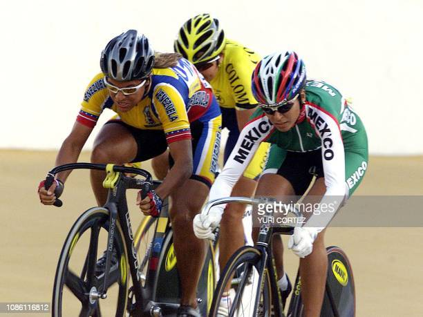 The Venezuelan Daniela Larrea the Colombian Diana Garcia and the Mexican Nancy Contreras compete 29 November 2002 in the madision event of the XIX...