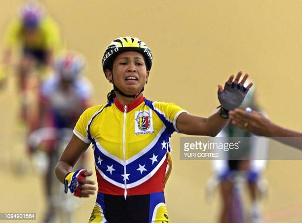 The Venezuelan Dayana Chirinos Nogoyon greets her coach 25 November 2002 in San Sallvador at the end of the schatch race competition Chirino won the...