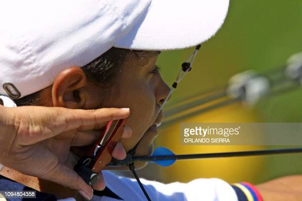 The Venezuelan Luzmary Guedez gets ready to shoot the arrow 27November 2002 while competing in the women's archery competition of 70 mts in the XIX...