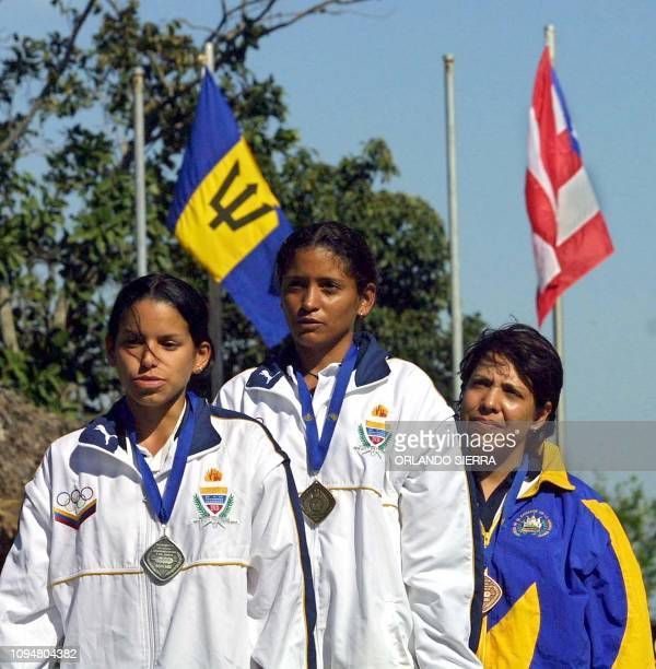 The Venezuelan Luzmary Guedez sings the national anthem of her country 27 November 2002 in Merliotwest of San Salvadorafter winning the gold medal in...