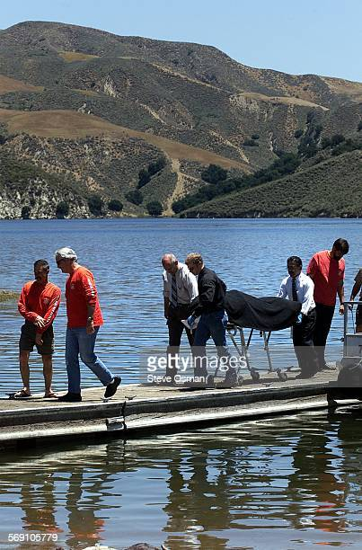 The Ventura County Coroner removes the body of Mark Charles Parker 52, of Thousand Oaks, from the dock at Lake Piru. Parker 52, and his 13 year old...