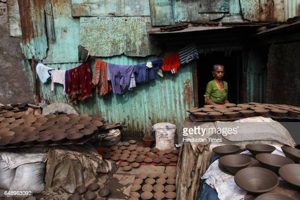 The veranda outside a woman's house Kumbhar wada at Dharavi is filled with earthernware diyas kept to dry for the approaching Diwali festival