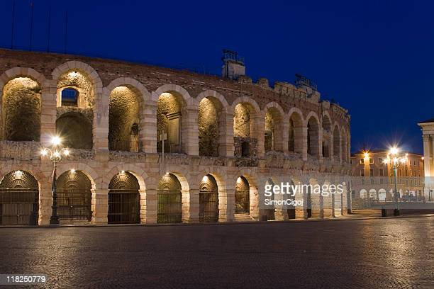 The Verona Arena at night with the interior lights lit