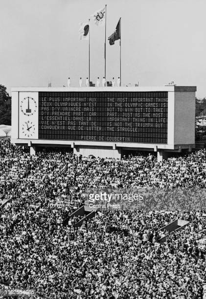 The verse of the Olympic ideal by Baron Pierre de Coubertin founder of the International Olympic Committee is displayed on the scoreboard during the...