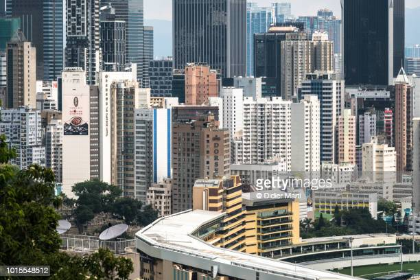the very dense happy valley residential district with its famous racecourse in hong kong island - wanchai stock photos and pictures