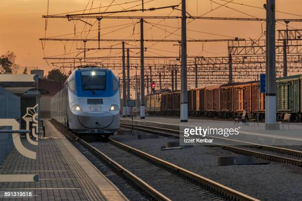 The very fast train entering the trains station of Samarkand, at dusk time, Uzbekistan'n