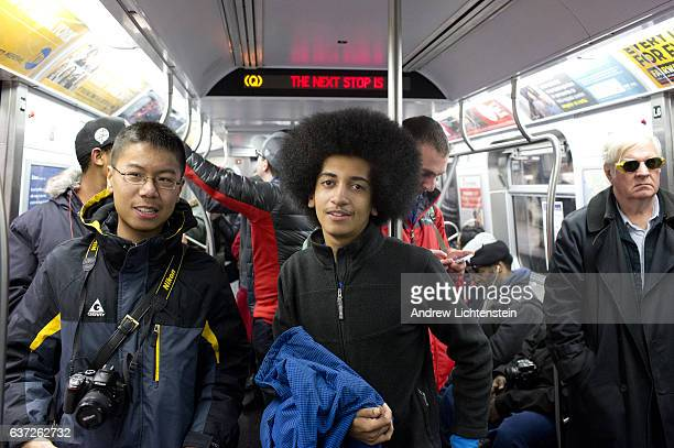 The very first 2nd Avenue subway train open to the public arrives as a Q train at 57th Street and subway enthusiasts board the front car for the...