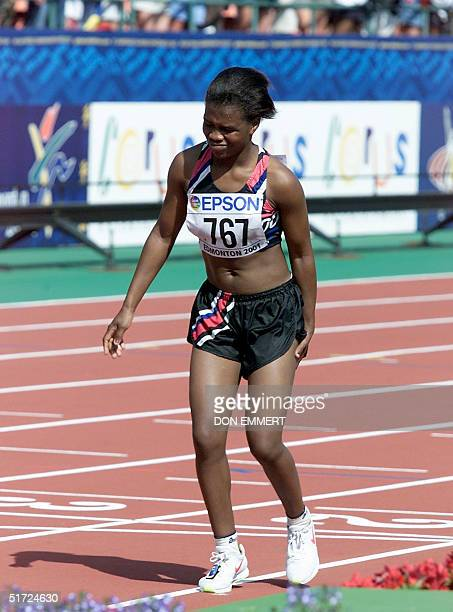The very last finisher in the women's marathon Lindiwe Maziya of Swaziland limps across the finish line at the 8th World Championships in Athletics...