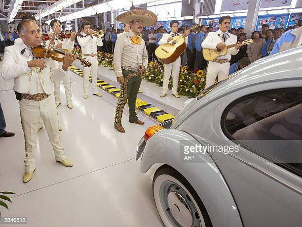 The very last VW beetle is serenaded by traditional Mexican Mariachi musicians as it rolls off the production line at VW's Puebla plant 30 July 2003...