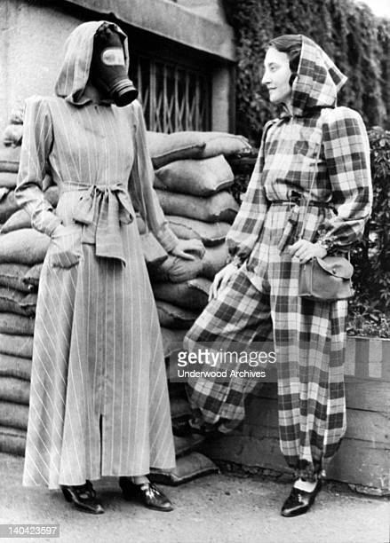 The very latest fashion in air raid shelter wear is a slip on dressing gown complete with hood and can be left open or zipped into trousers London...