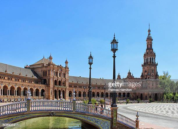 The very popular Plaza de Espana is a section of the public Maria Luisa Park in Seville built in 1928 for the IberoAmerican Exposition An example of...