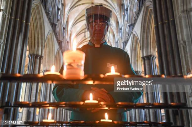The Very Reverend Nicholas Papadopulos, Dean of Salisbury, lights a prayer candle inside the Cathedral on June 15, 2020 in Salisbury, United Kingdom....