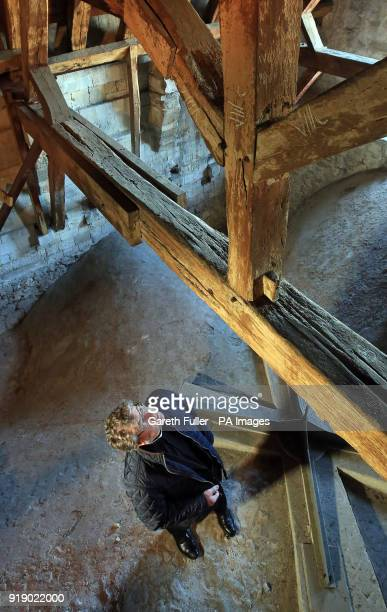The Very Reverend Stephen Waine Dean of Chichester Cathedral in West Sussex looks at the medieval timbers in the roof of the cathedral as the...