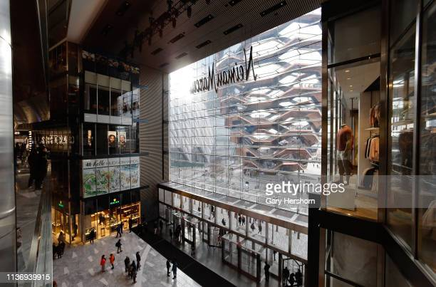 The Vessel is seen through a window from The Shops at Hudson Yards on March 18, 2019 in New York City.