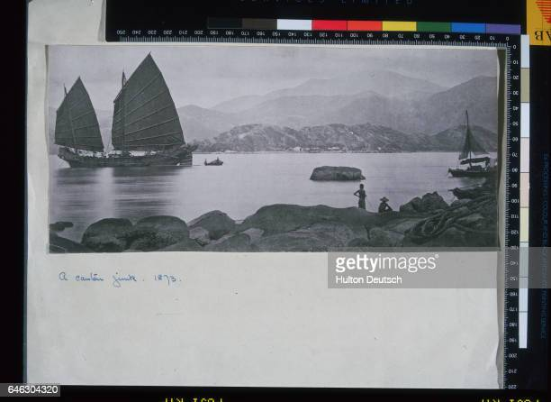 The vessel under sail on the left of the photograph is a coasting trader of Kwangtung build and may be regarded as one of the clipper fleet of...