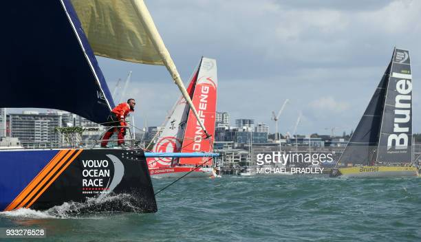 The Vestas 11th Hour Racing team Dongfeng Race Team and Team Brunel head out of Waitamata Harbour after the start of the seventh leg of the Volvo...