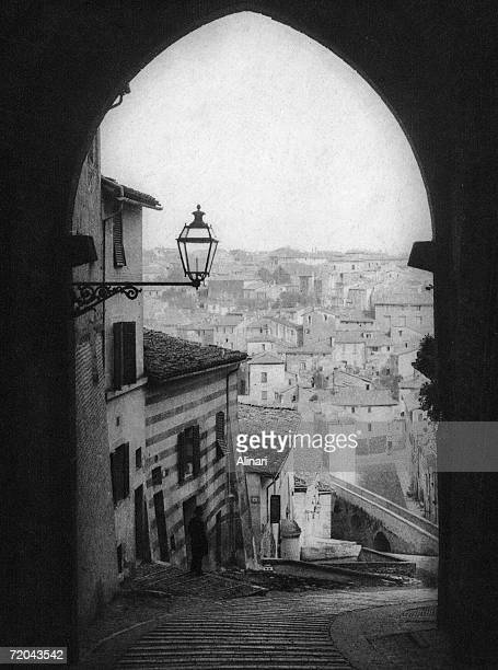 The Via Appia or Appian Way in Perugia with the aquaduct at the bottom circa 1900