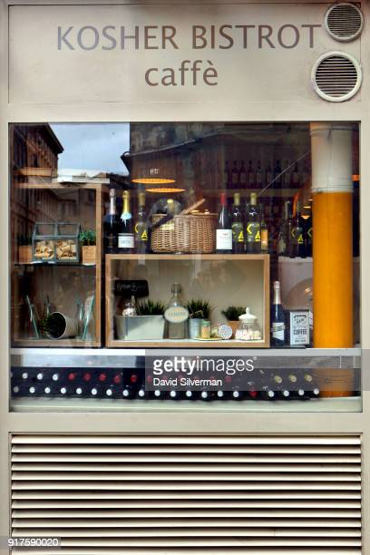 The Via del Portico d'Ottavia is reflected in the window of the Kosher Bistrot Caffè restaurant in the Jewish Ghetto on December 11 in Rome Italy The...