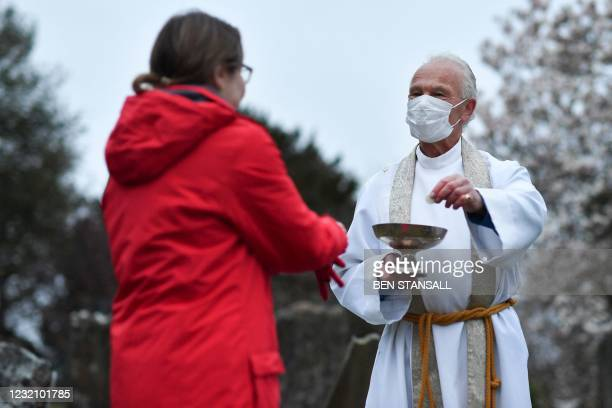 The vicar of Brenchley, Reverend Campbell Paget conducts an Easter Service at dawn in the churchyard of All Saints' Church in Brenchley in south east...