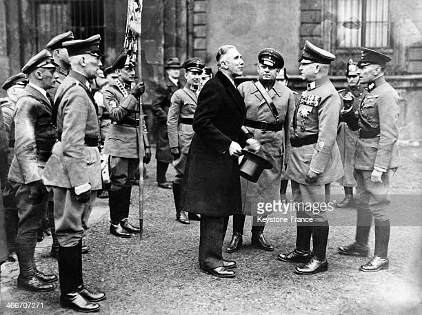Circa 1930: The Vice- Chancellor Von Papen, the Lieutenant Colonel Duesterberg and the General Seldte are talking together, surrounded by Nazi...