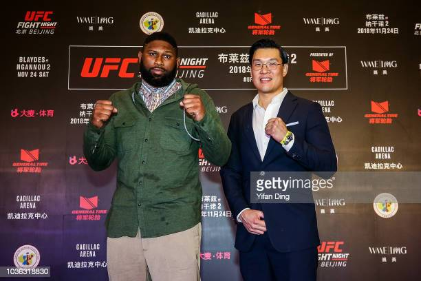 The vice president of UFC APAC Kevin Chang and UFC fighter Curtis Blaydes pose for photo during UFC Fight Night Beijing OnSale press conference at W...