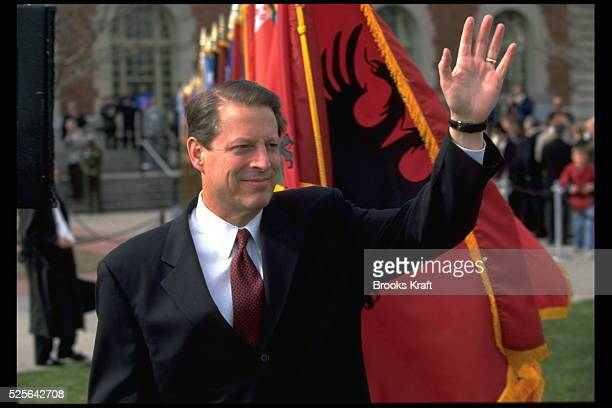 The Vice President salutes the crowd in front of and Albanian flag