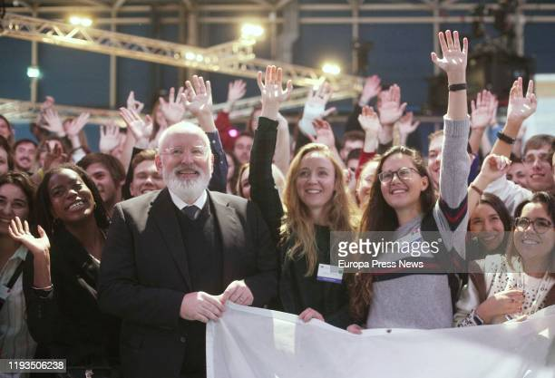The vicepresident first of the European Union Frans Timmermans poses with some young activists during the eleventh day of the Climate Summit in Ifema...