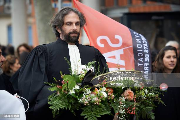 The viceprsident of the Bar Association carries a mortuary wreath symbolizing the death of JusticeThe French Bar Association all lawyers' unions all...