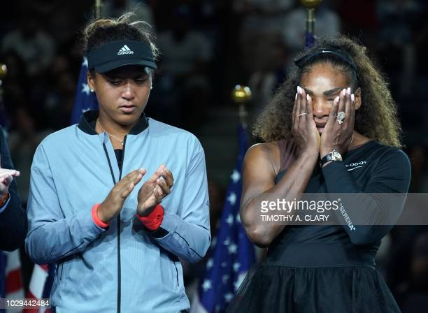 TOPSHOT The victor Naomi Osaka of Japan stands beside the defeated Serena Williams of the US following their Women's Singles Finals match at the 2018...