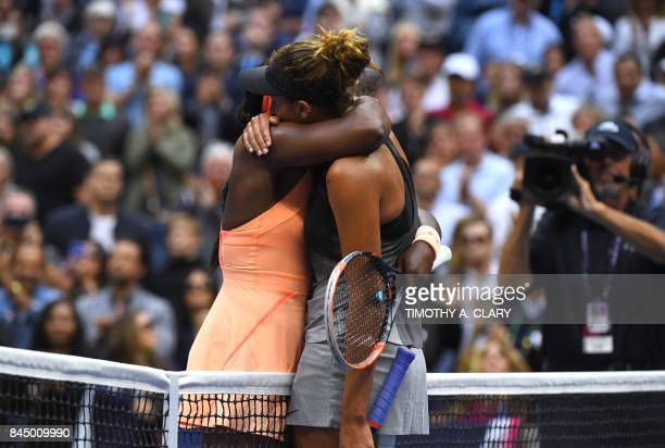 The victor Sloane Stephens of the US and compatriot Madison Keys embrace at the net following their 2017 US Open Women's Singles final match at the...