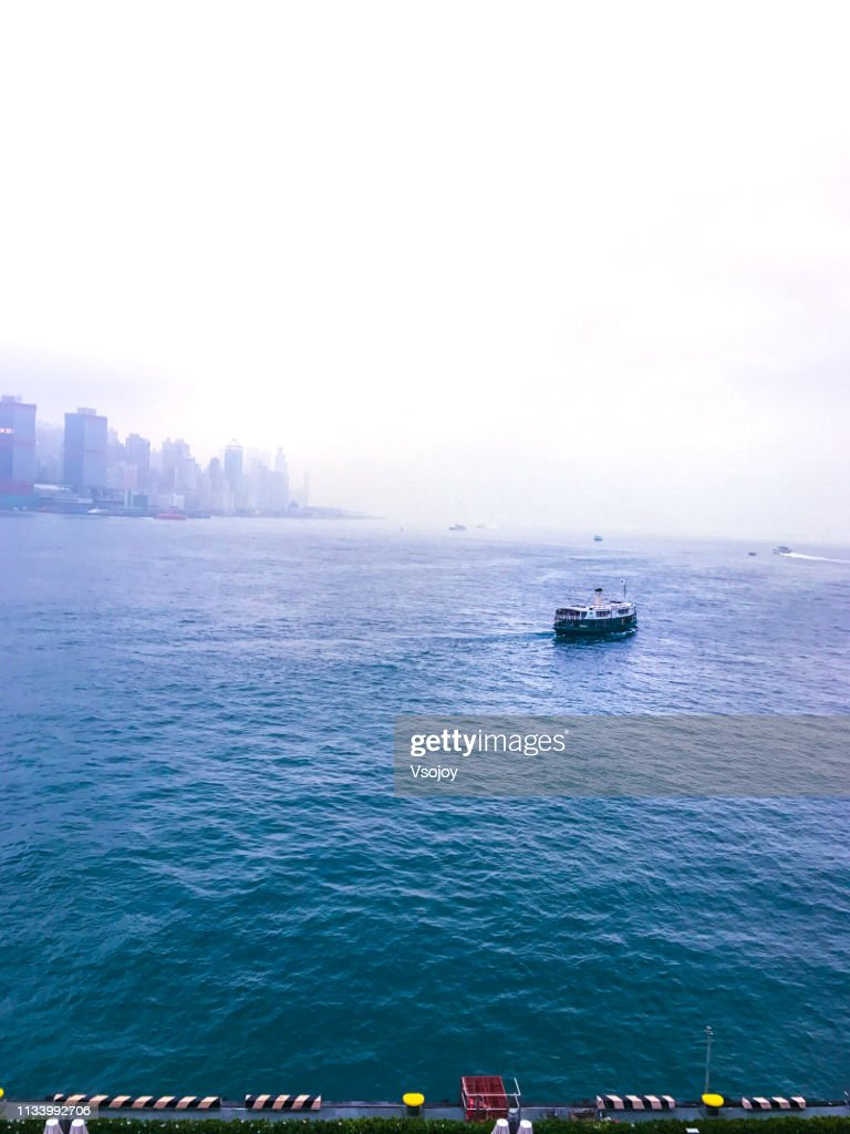 The Victoria Harbour Hong Kong in the fog : Stock Photo