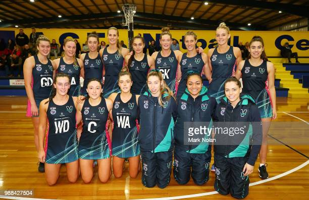 The Victorian Fury players pose for a team photo after the Australian Netball League third place playoff between the NSW Waratahs and Victoria Fury...