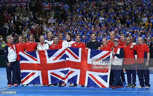 The victorias Great Britain team pose with the Union Jack following the singles match against Kei Nishikori of Japan on day three of the Davis Cup...