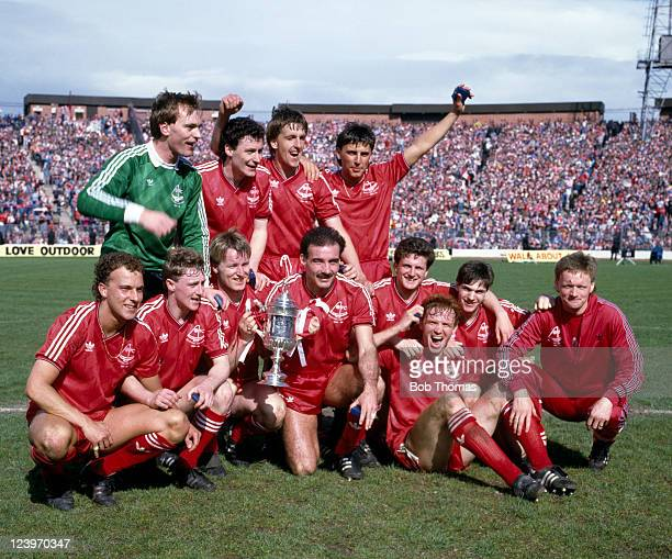 The victorious Aberdeen team with the trophy after their 30 victory over Hearts in the Scottish FA Cup Final at Hampden Park in Glasgow 3rd May 1986...