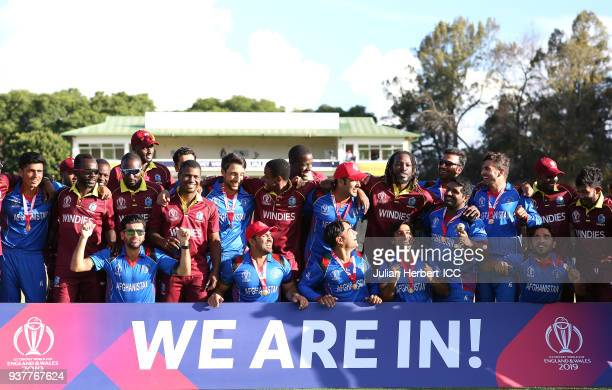 The victorious Afghanistan team mis with West Indian players after winning The ICC Cricket World Cup Qualifier Final between The West Indies and...