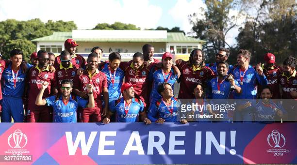The victorious Afghanistan team mixes with members of The West Indies team after The ICC Cricket World Cup Qualifier Final between The West Indies...